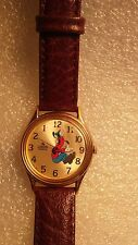 GOLD TONE LORUS BACKWARD RUNNING GOOFY WATCH NEW BATTERY AND LEATHER BAND