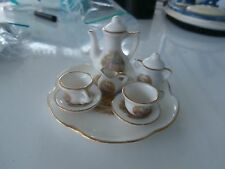 toy china tea set 10 pc. tea pot/lid, 2 cups with 2 saucers, sugar bowl/ creamer