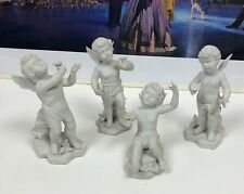Four Parian Or Bisque Porcelain Winged Cherub Putti Figurines