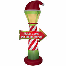 The Holiday Aisle Santa's Workshop Lamp Post and Sign Inflatable