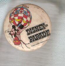 #D170. DISNEY ON PARADE TIN BADGE
