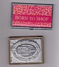 1  BUSINESS CARD HOLDER AND THE OTHER A MIRROR COMPACT .