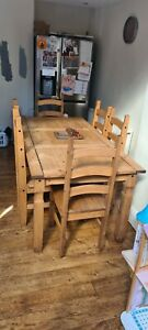 Wooden dinning table and 6 chairs