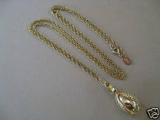 bow and 28 inch chain Joan Rivers goldtone egg pendent w