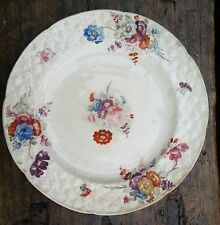 Early hand painted cream plate. Border embossed  9 inches.Sprays of Summer flowe