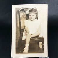 VTG RPPC Postcard Pretty Little Baby Girl Toddler on Chair Bow in Hair Antique