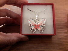 Brand new necklace with a pink enamel butterfly on an 18in chain and gift box