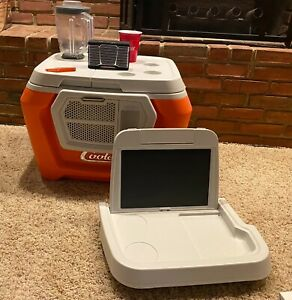 Coolest Cooler: Orange with Blender, 2 bluetooth speakers and solar lid!