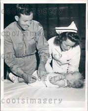 1945 Cincinnati OH Nurse Teaches IN Soldier n School For Diapering Press Photo