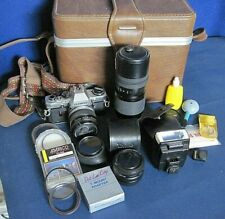Vintage Olympus OM10 camera with zoom, lenses, manual adapter, flash T20 +++