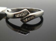 9ct white gold diamond cross over ring with Birmingham hallmark DHM T272
