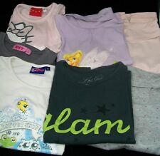 Lot 7 Tee-shirts dont HELLO KITTY & DISNEY & LITTLE GIRLS.        Age 6 ans.