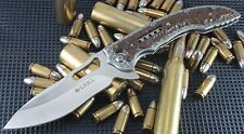Couteau CRKT Ikoma Fossil Lame Acier 8Cr13MoV Manche 2Cr13/G-10 CR5470