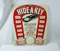 Vintage HIDE A KEY Store Counter Display Metal NOS 14 x 11 Advertising Sign