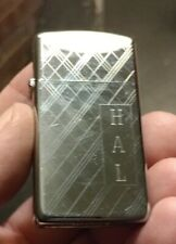 1980s  Zippo lighter slim criss cross design slim with HAL engraved on front