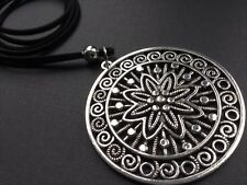 Long Black Suede Necklace With A Large Statement Ethnic Tibetan Disc Pendant