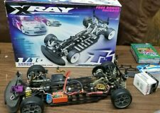 XRAY T1 1/10 vintage Electric 4WD RC Car w/ original box, manuals, cert of auth