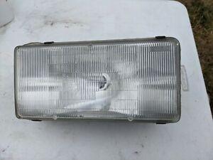 Cadillac fleetwood brougham headlight Assembly 91 92 93 RIGHT w BRACKET