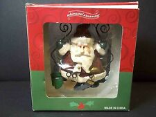 Carved look resin Santa Whimsical ornaments for Costco in original box
