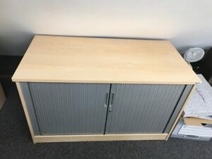 1.2m Side Tambour Cupboard Maple With Silver Doors, 1 Shelf And Key