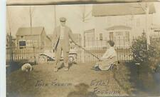 South Dakota, SD, Groton, Woman Being pulled in cart by husband 1910 RPPC
