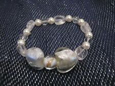 Very pretty elasticated bracelet with shimmery clear beads & 2x heart shaped