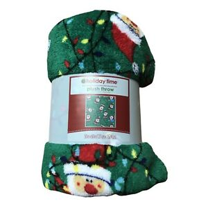 Holiday Time Plush Throw Christmas Tangled Santa in Lights on Green 50 x 60 in.