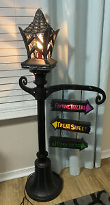 Rare Halloween Gemmy Flicker 4 Foot Lighted Lamp Post w/Flame Directional Signs