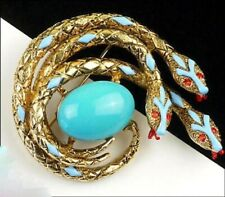 Arthur Pepper, signed ART. Triple figural snake brooch with turquoise cabochon.
