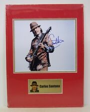 Photo signed by CARLOS SANTANA with COA, double matted