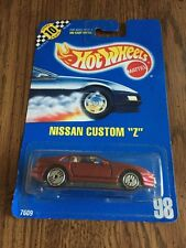 1991 Hot Wheels Collector Blue Card #98 - NISSAN CUSTOM Z - Dk Red - 7609 - NMB