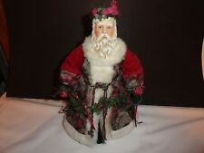 Beautiful Red Velvet And Tapestry Dressed Santa Holding A Garland Of Greens