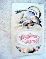 Unposted embossedThanksgiving Greetings postcard with turkey circa 1910's