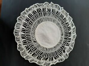 Vintage round white hairpin crocheted cloth with stars in centre.