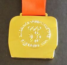 1984 SARAJEVO WINTER OLYMPICS GOLD MEDAL WITH SILK RIBBON & STORAGE POUCH