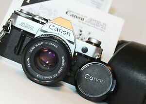 CANON AE-1 35mm SLR Film Camera FD 50mm f1.8 Lens WORKING excellent NEW SEALS