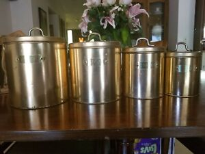 vintage copper plated kitchen canister set with brass labels