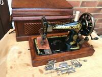 Antique 28K Old Singer sewing machine with coffin storage Case and attachments