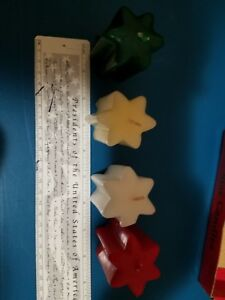 """Set of 4 different colored holiday star shaped wax candles 2"""" high never used"""