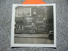 SNAP SHOT OF CIGAR STORE  ADVERTISING SIGNS COCA COLA OR CRUSH WINCHESTER CIG