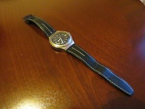 Swatch mens wristwatch. Leather strap. New battery installed.