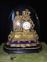 19th century french ormolu bracket clock on a plinth under glass dome