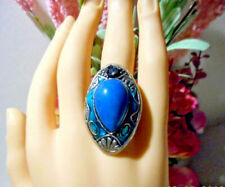Handmade Artisan ring made with Tibetan silver blue stones and green enamel.