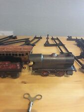 VINTAGE COLLECTABLE TIN  TRAIN SET WORKING WITH LOTS OF METAL TRACK.