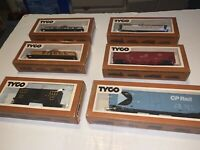 Lot of six Tyco HO train cars with boxes