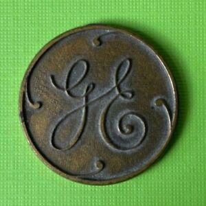 VINTAGE Original Solid Brass General Electric disc coin charm VTG GE emblem logo