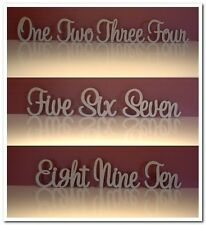 Set of 10 wooden freestanding table numbers written in words for wedding decor