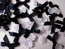 25 NAVY SATIN TIE BOWS 30MM & 25 WHITE LACE GUIPURE FLOWERS 16MM