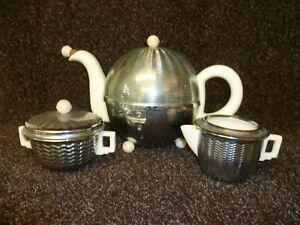 A RETRO c1950s 'HEATMASTER' HEAT RETAINING BALL SHAPE CHROMIUM PLATED TEA SET.