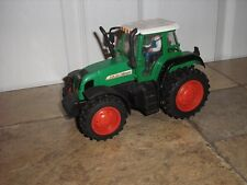 """RARE Vintage 8 7/8"""" long Farm Tractor with a driver and pull back action"""